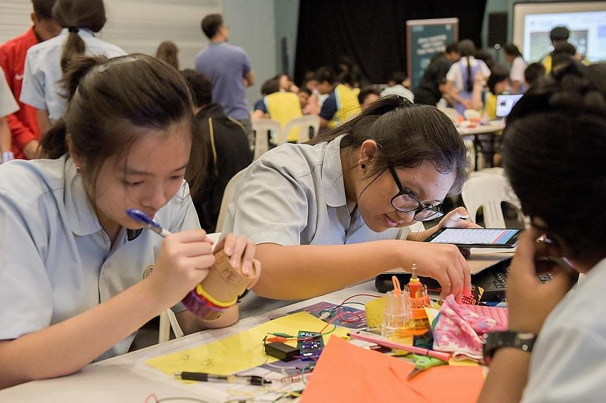 All Hong Kah Secondary School student Teoh Yu Yun (in spectacles) was given was a broken fan. For over an hour, the 15-year-old worked with her group members, Kelly Choy Mun Yee (far left) and Ramamoorthi Gopika, to turn the fan into a water sensor t