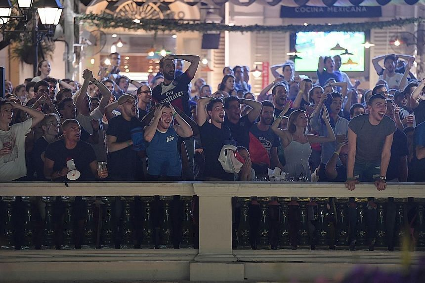 A moment of tension for France fans while watching the World Cup semi-final against Belgium at El Mero Mero at Chijmes.
