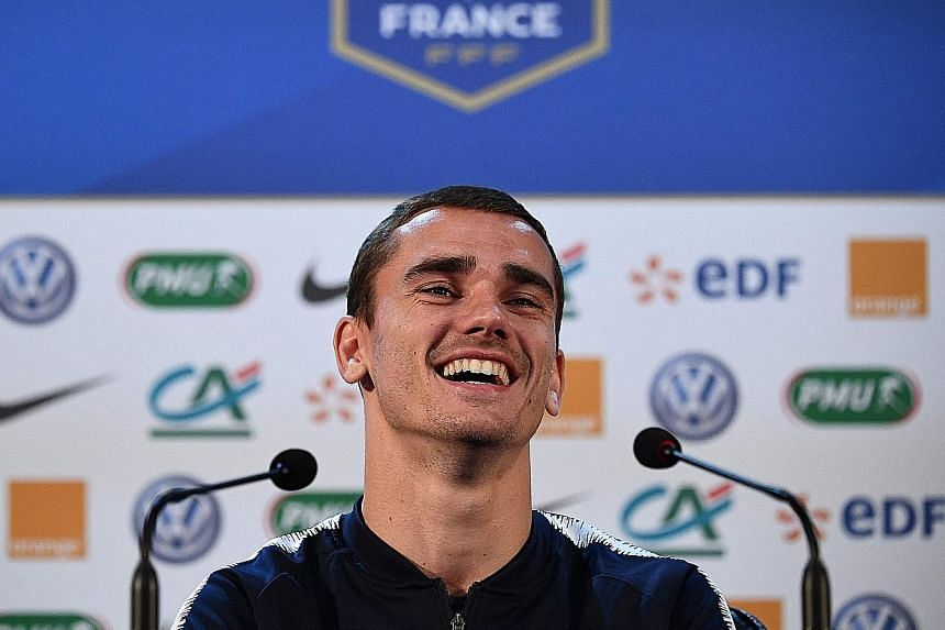 France striker Antoine Griezmann in a relaxed mood at the team's training base outside Moscow yesterday, ahead of tomorrow's World Cup final against Croatia. He took a swipe at Belgium's Thibaut Courtois for criticising France's style of play in thei