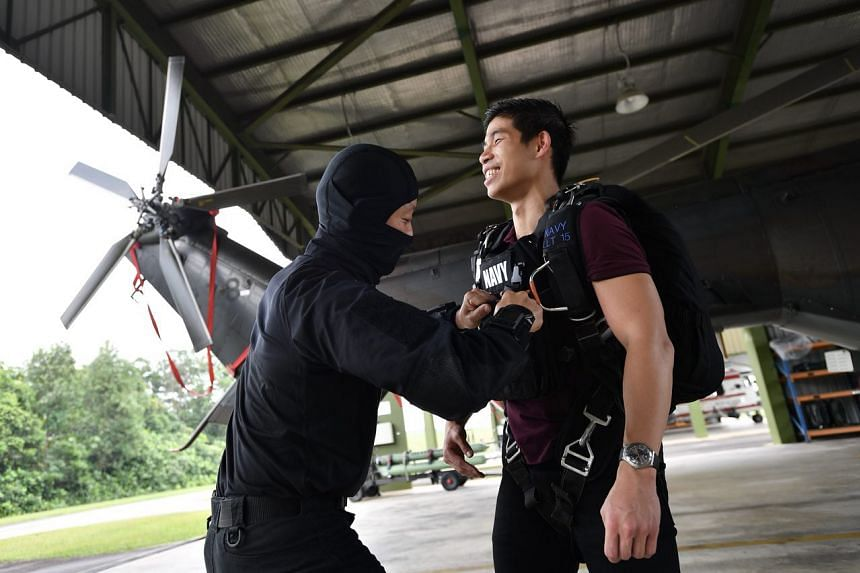 Journalist Jose Hong trying naval combat divers' gear.