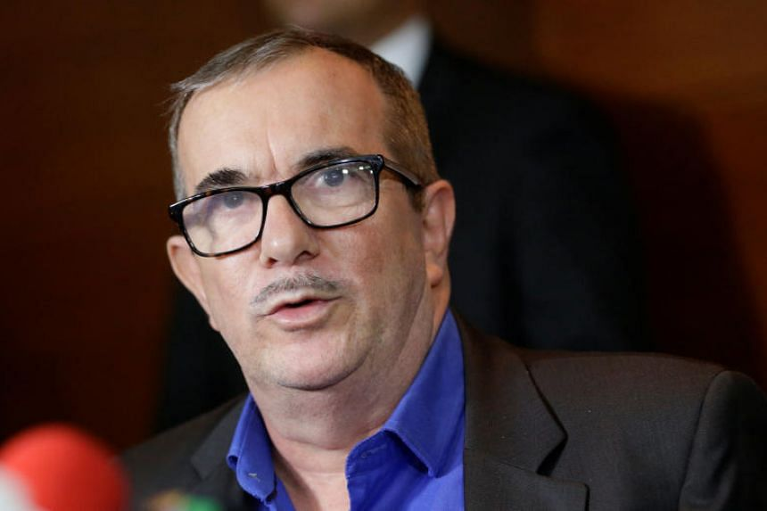 """Colombian former Farc rebel leader Rodrigo """"Timochenko"""" Londono speaks to the media after attending a hearing of the Special Jurisdiction for Peace tribunal in Bogota on July 13, 2018."""
