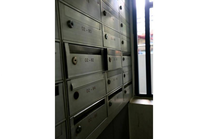 More than 10 letterboxes at Block 10 Jalan Bukit Ho Swee View had visible signs of being tampered with.