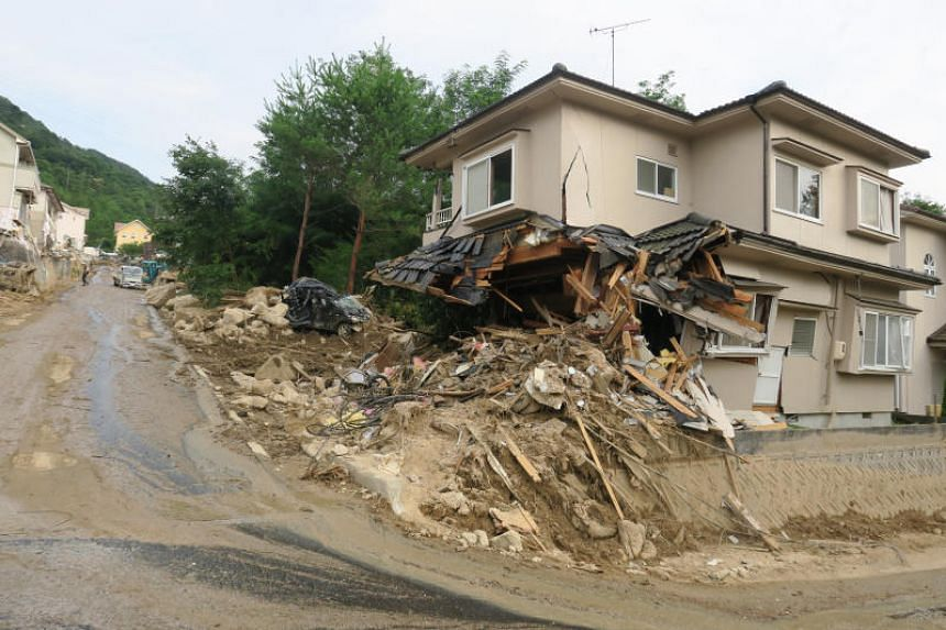 """The historic rains turned deadly for residents of a neighbourhood known as """"Ohara Heights"""" in Kawasumi 5-Chome, Kumano district, Hiroshima prefecture, when it triggered a landslide which sent boulders and mud down into the neighbourhood, flattening h"""