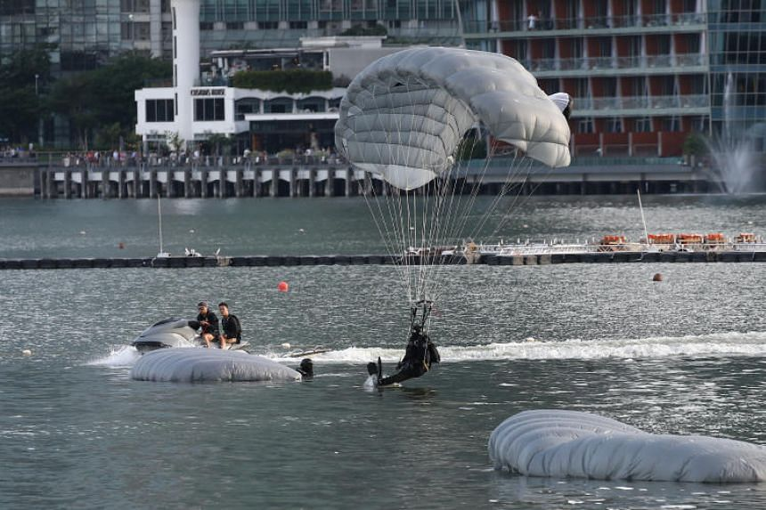 The divers from the Naval Diving Unit will drop 1,800m from a Super Puma helicopter into the waters around the Marina Bay floating platform.