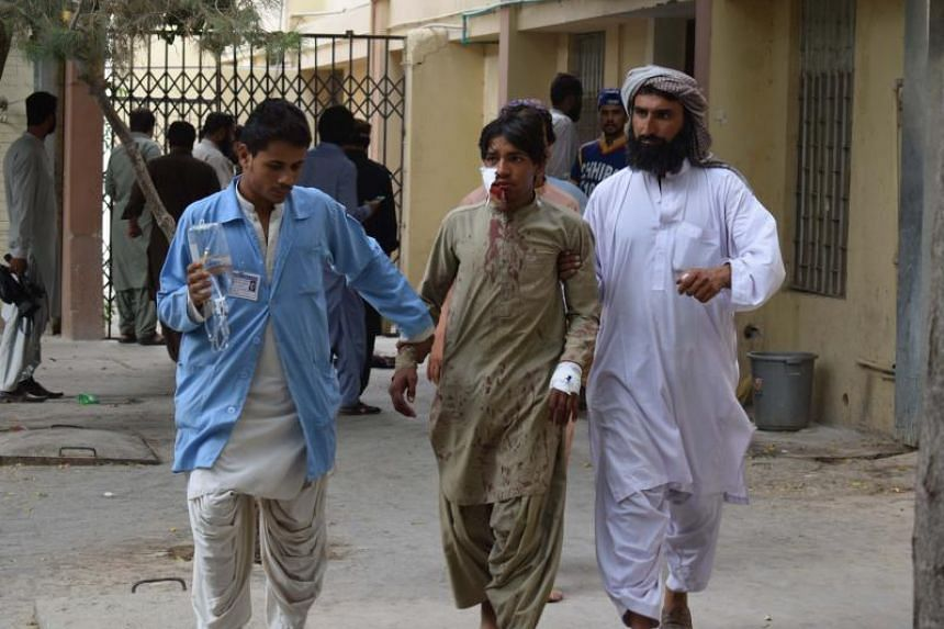 A victim of a bomb blast is brought to a hospital in Quetta on July 13, 2018, following an attack at an election rally.