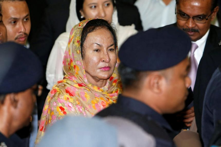 Rosmah Mansor, wife of Malaysia's former Prime Minister Najib Razak, leaves a courtroom in Kuala Lumpur on July 4, 2018.
