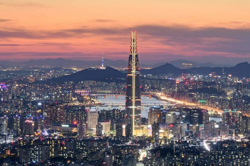 A file photo of the Seoul skyline. South Korea will raise the minimum wage by 10.9 per cent to 8,350 won (S$10.11) an hour next year.