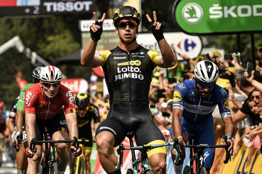 Groenewegen celebrates as he crosses the finish line ahead of Germany's Andre Greipel (left) and Colombia's Fernando Gaviria to win the eighth stage.