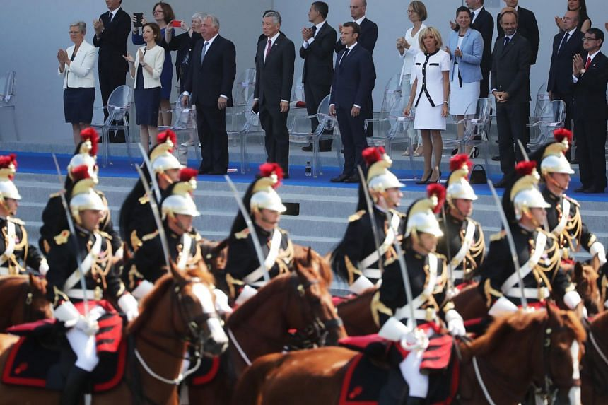 Prime Minister Lee Hsien Loong attends the French National Day parade at the invitation of French President Emmanuel Macron and his wife Brigitte.