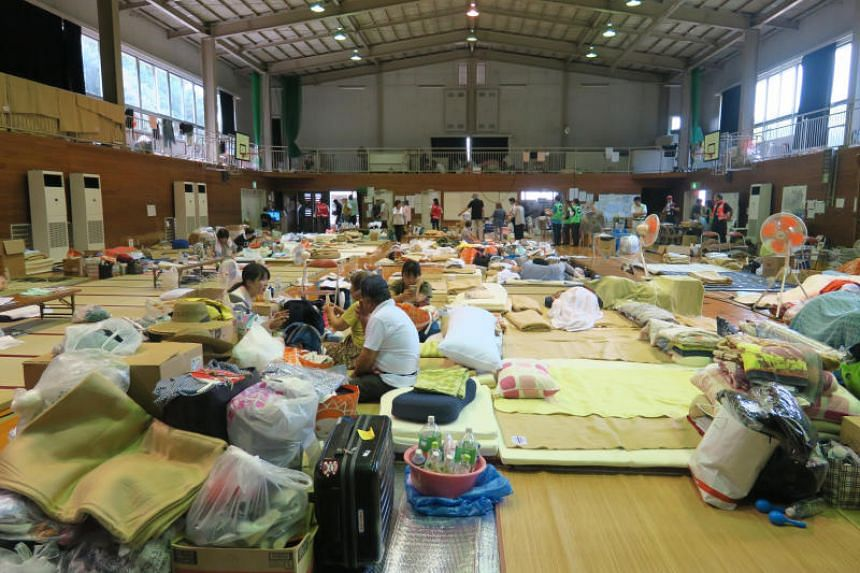 The school hall of Nima Elementary School in Kurashiki, Japan, has been converted into a makeshift evacuation shelter.