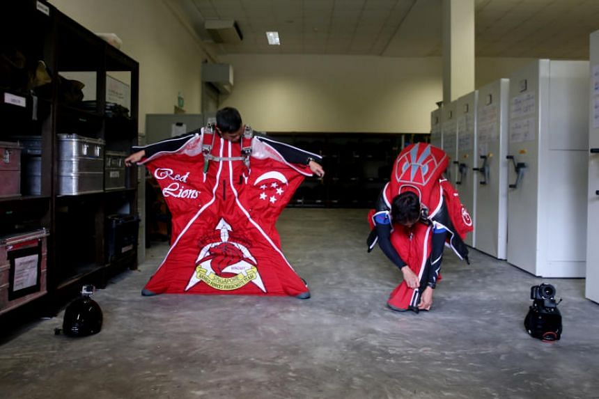 For the first time in parade history, the Singapore Army's Red Lions will be donning bright-red wing suits and will be making the display jump from a greater height of 3,800m.