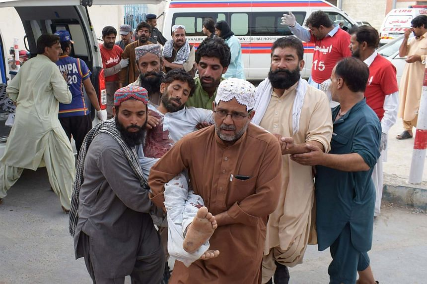 An injured Pakistani man is brought to a hospital in Quetta, on July 13, 2018, following a bomb blast at an election rally.