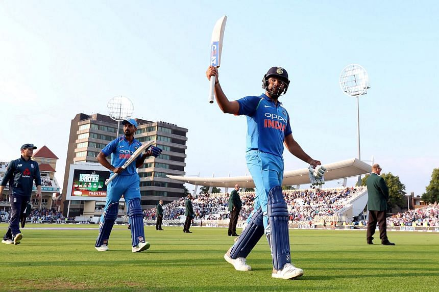 India's Rohit Sharma salutes the crowd after victory.