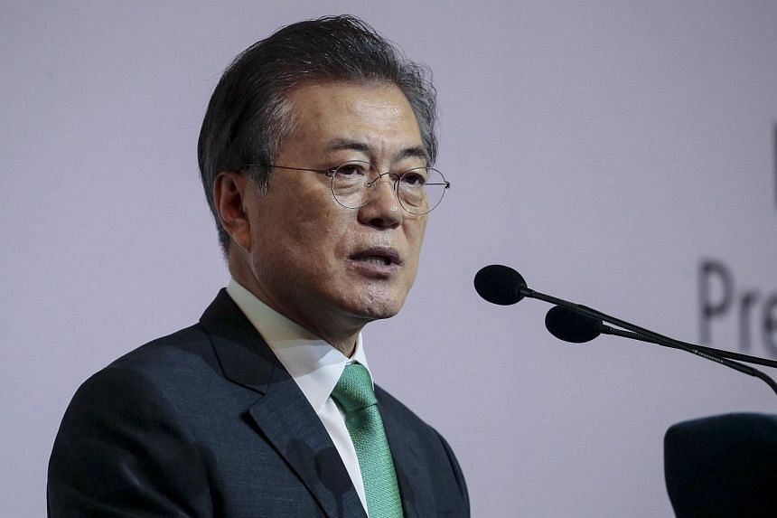South Korea President Moon Jae-in delivers his address for the 42nd Singapore Lecture at the Orchard Hotel in Singapore, on July 2018.
