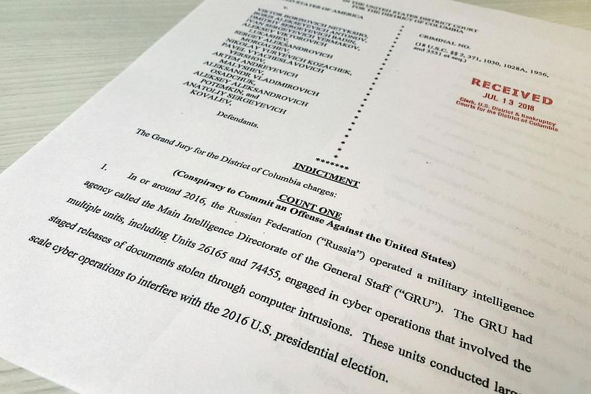 Attractive A Copy Of The Grand Jury Indictment Against 12 Russian Intelligence  Officers Is Seen After The