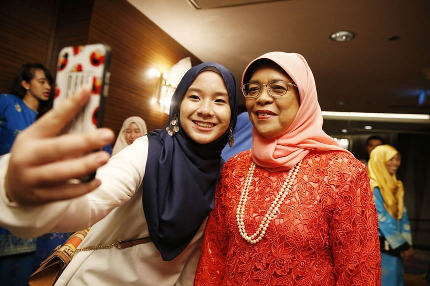 President Halimah Yacob taking a selfie with intern Nur Hazwani, 22, at a dinner to celebrate the 70th anniversary of the Malay Youth Literary Association (4PM) at Mandarin Orchard last night. The eventpaid tribute to 4PM's volunteers for their dedic