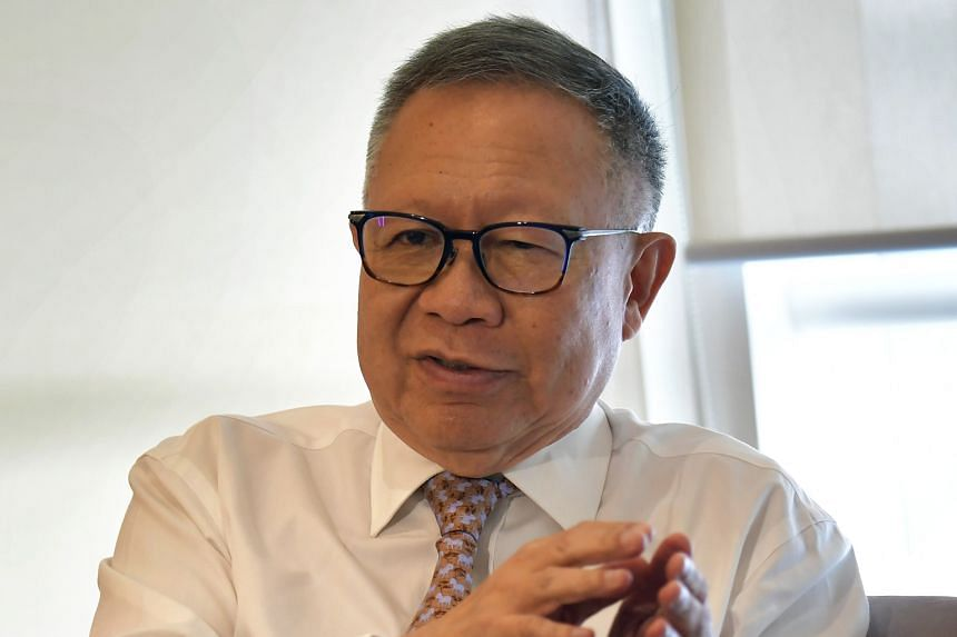 Public Service Commission chairman Eddie Teo (left) is retiring at the end of the month, and will be succeeded by deputy chairman Lee Tzu Yang.