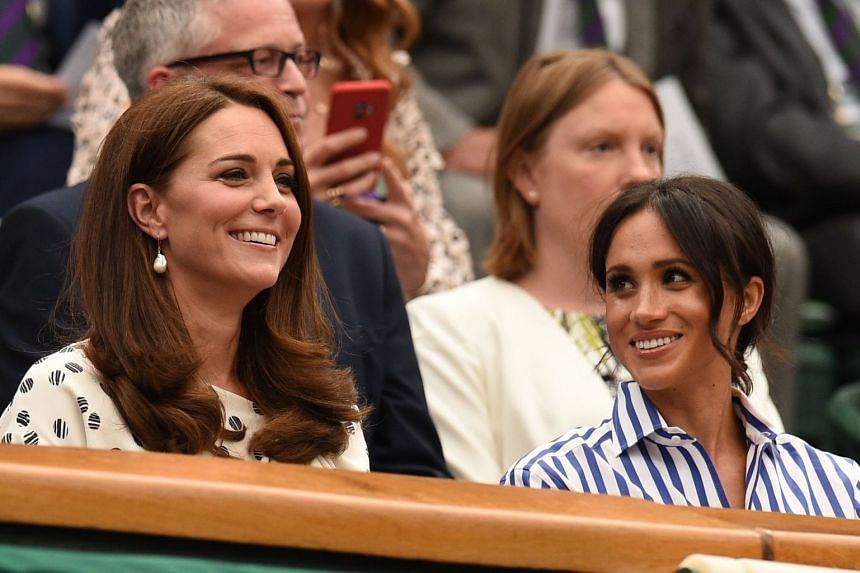 Britain's Catherine, Duchess of Cambridge, (left) and Britain's Meghan, Duchess of Sussex, watch from the Royal Box