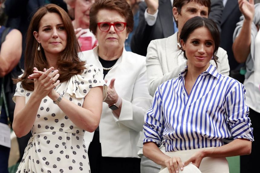 Britain's Catherine, Duchess of Cambridge (left) and Meghan, the Duchess of Sussex, in the Royal Box.