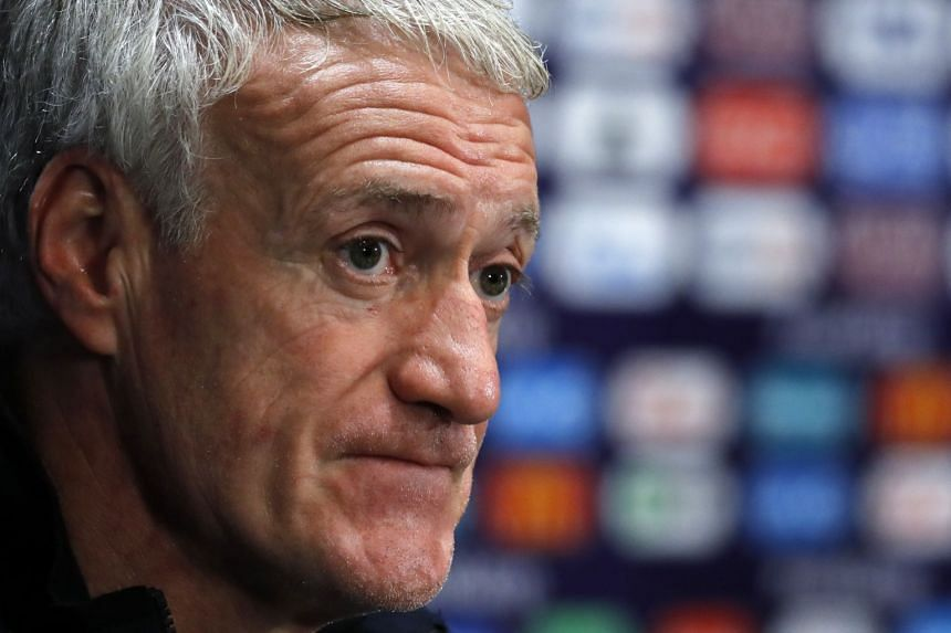 French head coach Didier Deschamps attends a press conference in Moscow.