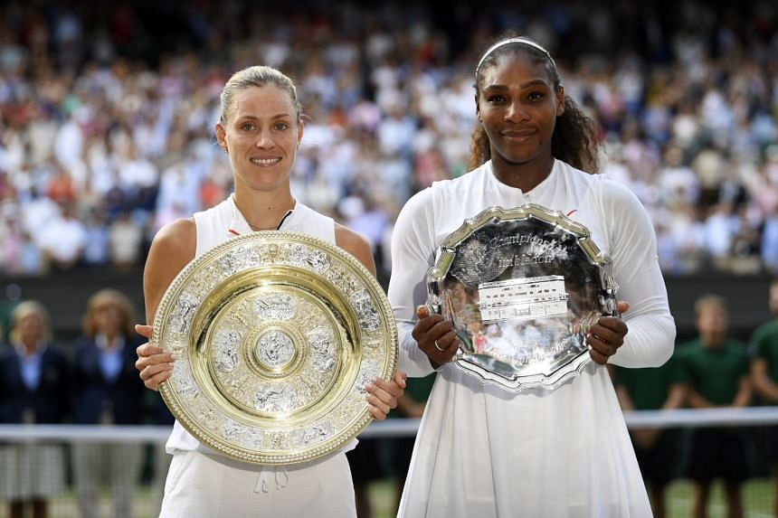 Kerber holds the Championship Trophy (left) and Williams, the runners-up trophy.