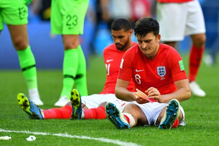 England's Harry Maguire looks dejected.