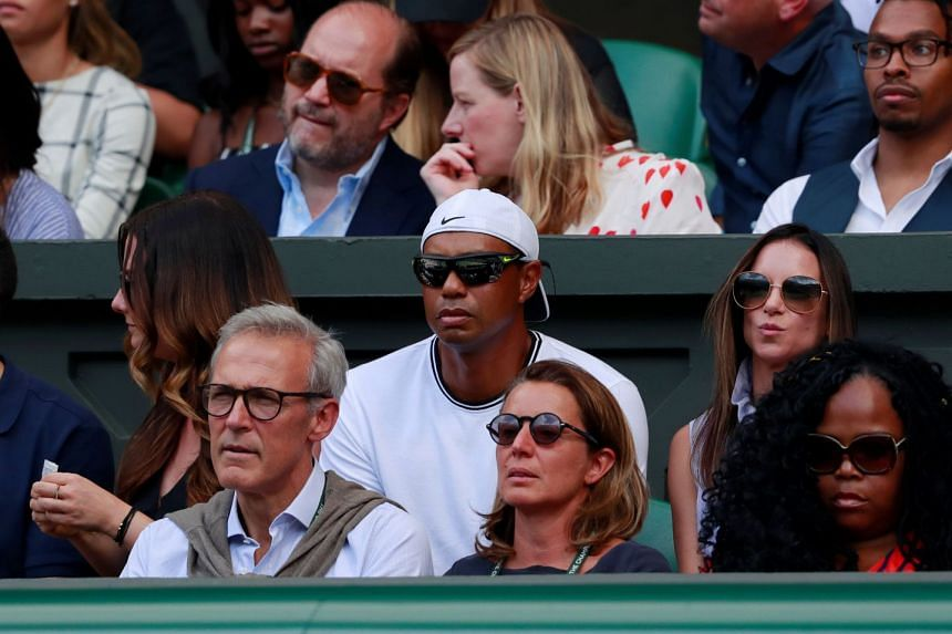 Golfer Tiger Woods in the stands on centre court.