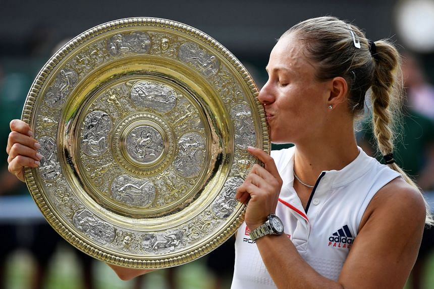 Kerber holds the trophy after winning the women's singles final against Serena Williams.