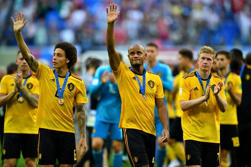 Belgium's Axel Witsel, Vincent Kompany and Kevin De Bruyne after receiving bronze World Cup medals.