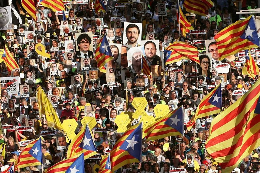 People hold banners during a protest against the imprisonment of the Catalan separatist leaders, in Barcelona.