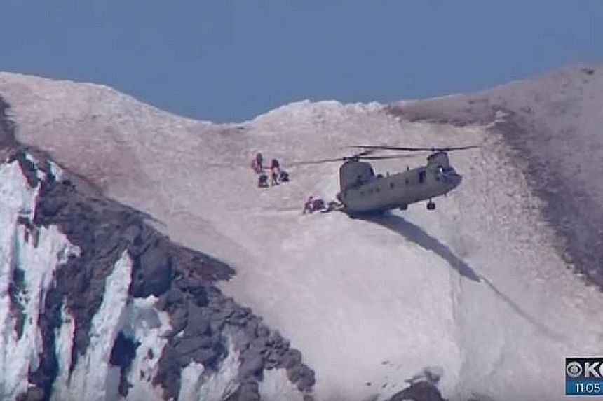 A helicopter lifted the man, who had earlier been found unhurt, and his six rescuers from the summit of Mount Hood in Oregon to safety.