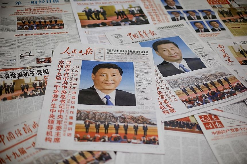 The front page of the Communist Party's flagship newspaper the People's Daily and other newspapers. A Financial Times investigation found that party-affiliated outlets were reprinting or broadcasting their content in at least 200 nominally independen