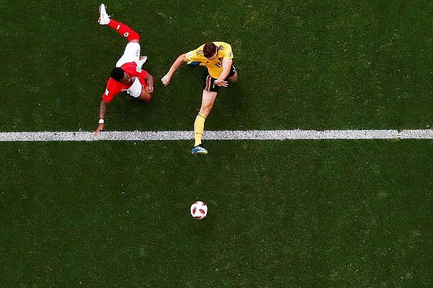Thomas Meunier slotting the ball past Jordan Pickford for Belgium's opening goal.