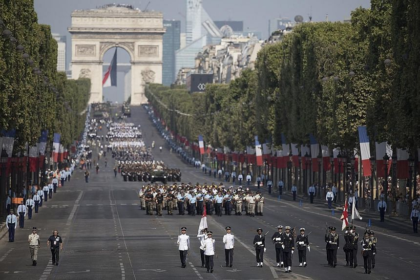 Troops on the Champs-Elysees during the Bastille Day parade in Paris yesterday. Prime Minister Lee Hsien Loong was a guest of honour at France's National Day Parade at the invitation of President Emmanuel Macron.
