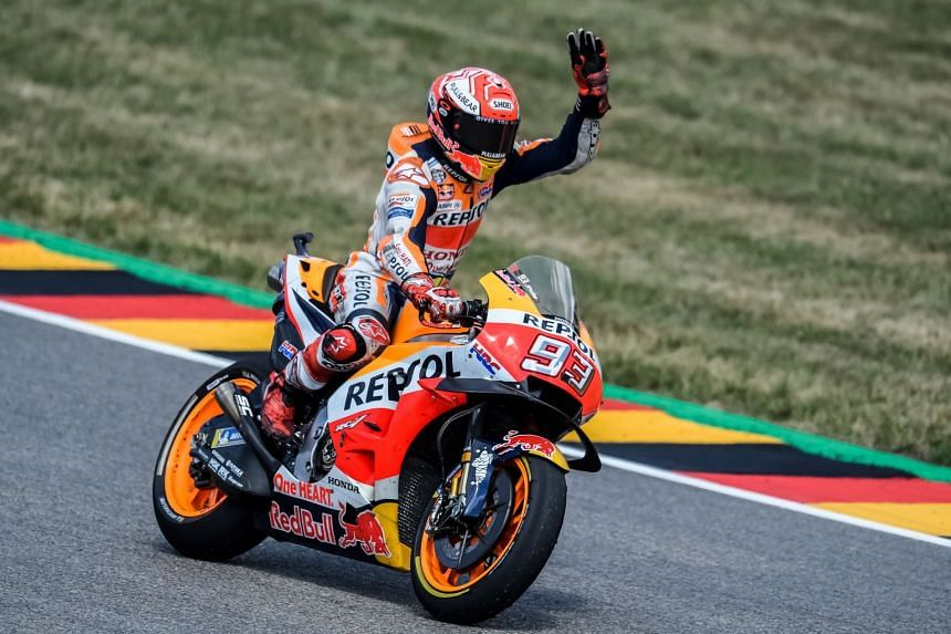 Repsol Honda rider Marc Marquez celebrating after winning the Motorcycling Grand Prix of Germany on July 15, 2018.