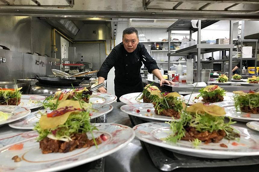 Head chef Joe Chiang of Turandot Moscow's Chinese cuisine department, with his adaption of the crispy duck salad that fetches 600 orders a month.