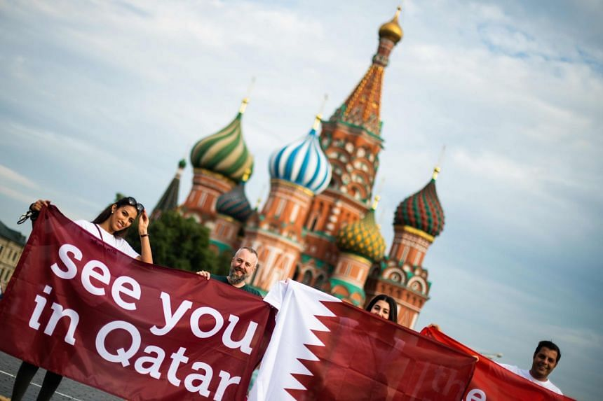 "Fans holding up a ""See you in Qatar"" sign in reference to the next World Cup, in Moscow on July 14, 2018."