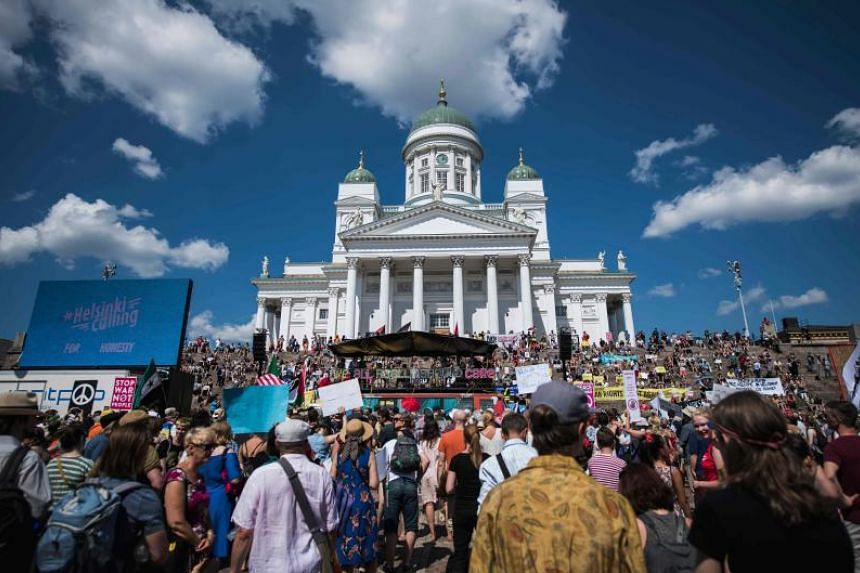 "Protesters gather on the Senate Square at the end of the so-called ""Helsinki Calling"" march to defend the human rights, freedom of speech and democracy on July 15, 2018."