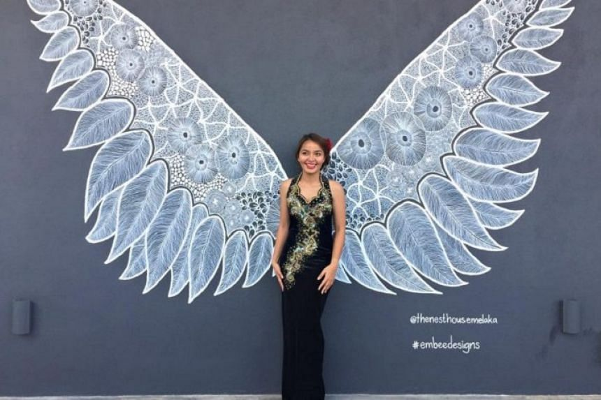 Graffiti wings at the rooftop garden wall for individual and group pictures.