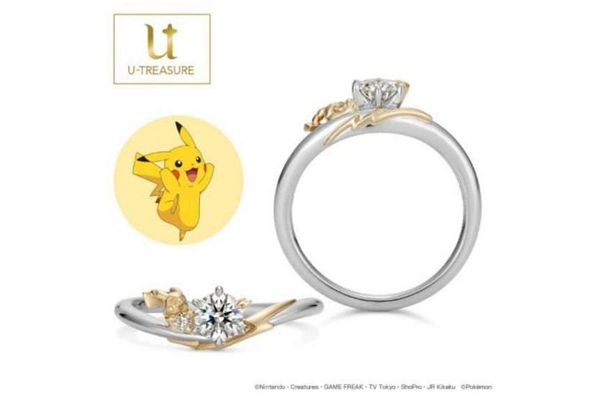 Platinum and yellow gold variant of the engagement ring which features Pikachu holding a small melee diamond beside the central diamond.