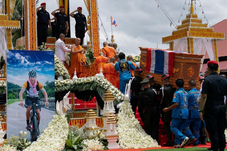 Military personnel carrying the diver of Saman Gunan, the former Thai navy diver who died trying to rescue the trapped youth football team, during his funeral on July 14, 2018.