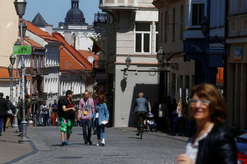 People walk in the Old Town of Vilnius, Lithuania.