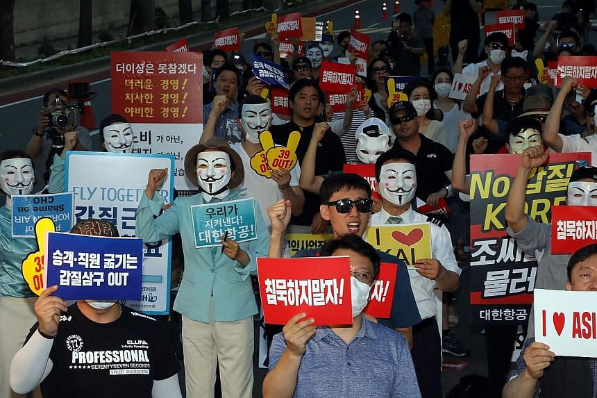 Korean Air and Asiana Airlines employees protesting in Seoul.