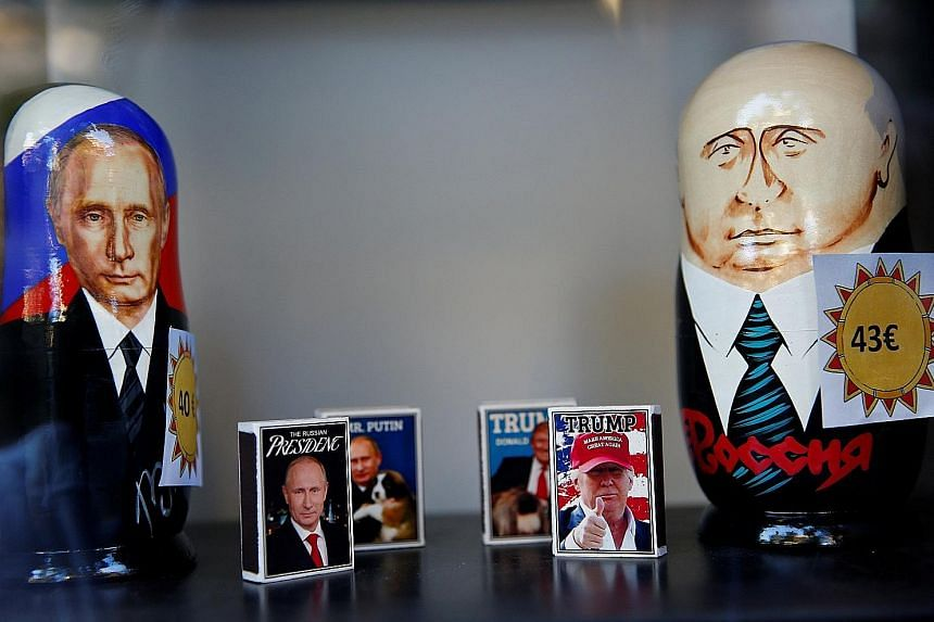 Matchboxes with pictures of Russian President Vladimir Putin and US President Donald Trump in a shop window in Helsinki, Finland, yesterday, ahead of the historic summit between the two leaders today.