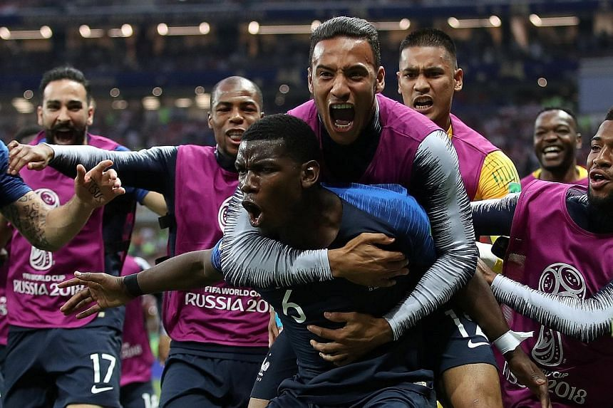 Pure delirium for France as they celebrate midfielder Paul Pogba's (No. 6) stunning goal which stretched their lead to 3-1 against Croatia in the World Cup final at the Luzhniki Stadium in Moscow.