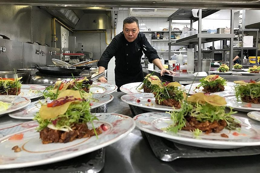 Joe Chiang, head chef of the Turandot restaurant's Chinese cuisine department, with his popular innovation of crispy duck salad, for which there are 600 orders a week.
