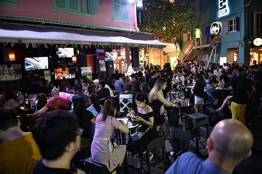Businesses in Clarke Quay (above) said they hoped for a level playing field as clubs elsewhere are able to get a 6am liquor licence.