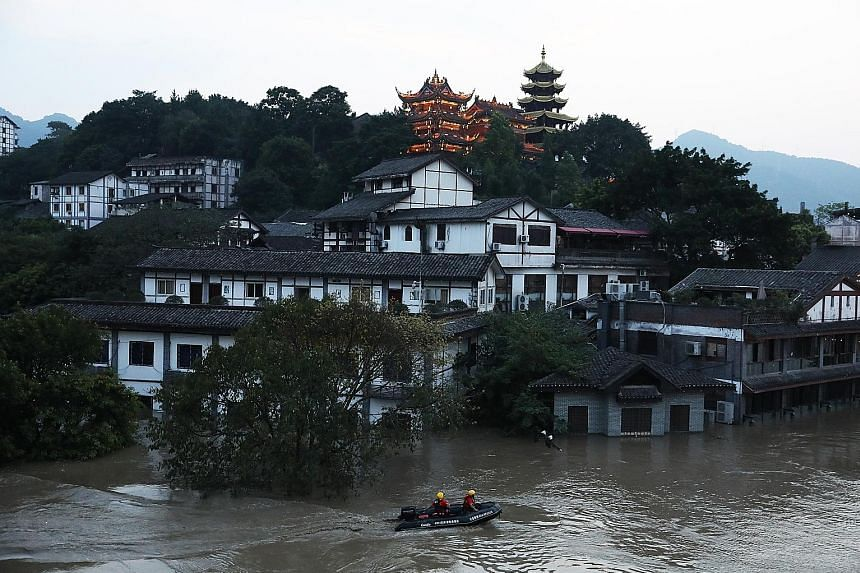 Anti-flood checks being carried out last Friday in the Jialing River, which flows through Chongqing city. At the Shuangliu International Airport in Chengdu, 52 inbound flights had to be diverted to other airports and more than 70 flights cancelled.