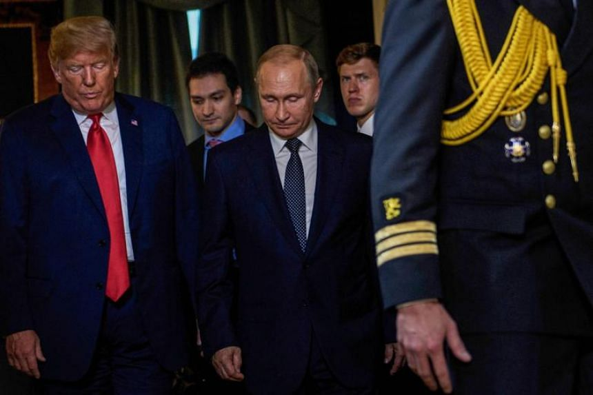 US President Donald Trump (left) and Russia's President Vladimir Putin (centre) arrive for a meeting at Finland's Presidential Palace in Helsinki, Finland, on July 16, 2018.