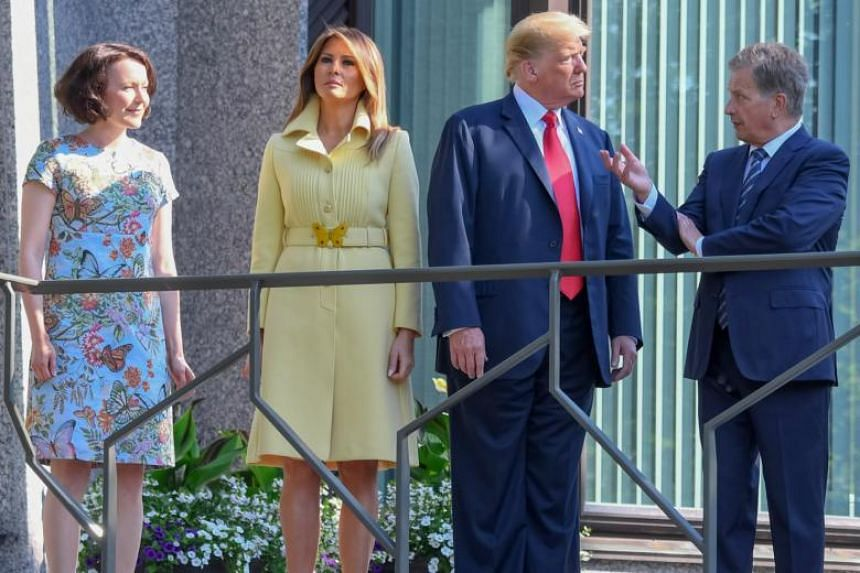 President of Finland Sauli Niinisto (right) and his wife Jenni Haukio (left) with US President Donald Trump (second right) and US First Lady Melania Trump (second left) at the Finland president's official residence in Mantyniemi, in Helsinki, Finland